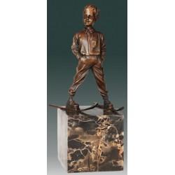 Bronze sculpture of boy on skis