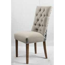 Button back upholstered chair with floral design